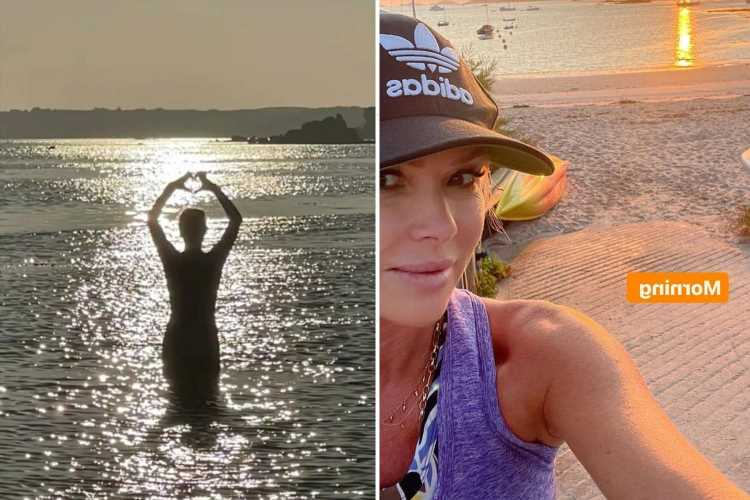 Amanda Holden shows off her figure in blue swimsuit as she takes a dip in the sea at sunrise