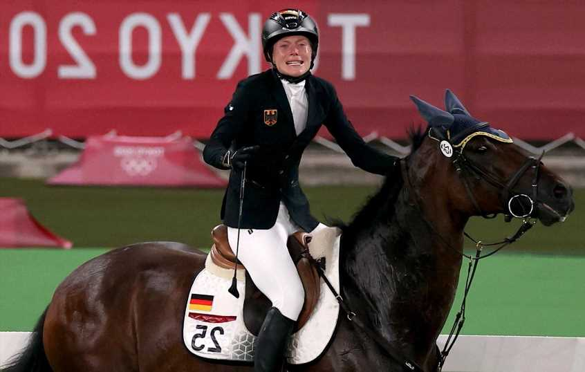 Germany's modern pentathlon coach disqualified after punching horse
