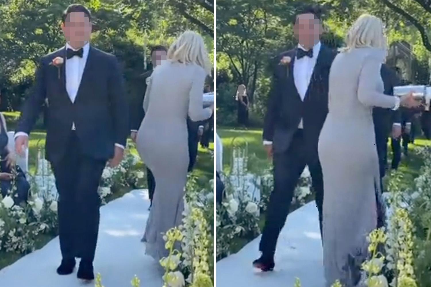 Moment step mother-in-law 'ruins wedding' by walking down the AISLE in cream coloured dress