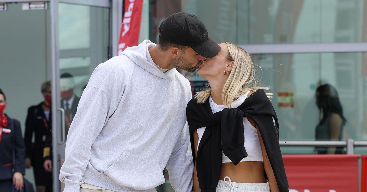 They're back! Love Island winners Millie and Liam put on loved-up display after landing in the UK