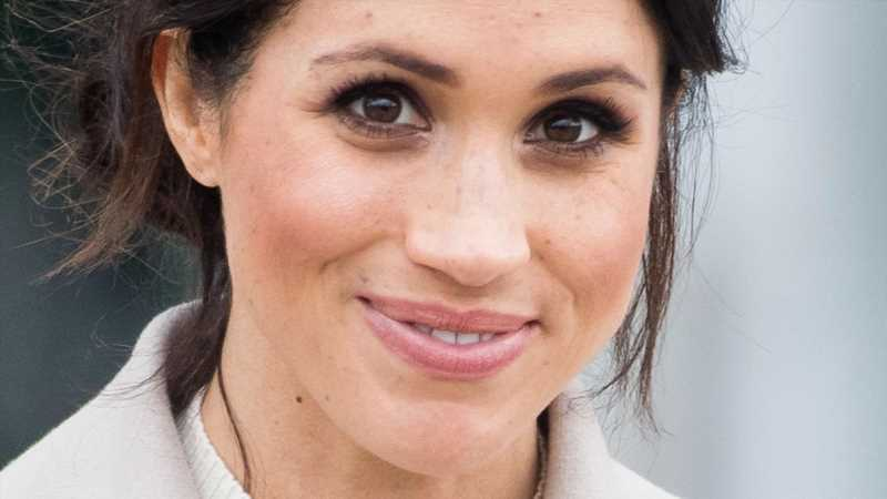 Why This Royal Expert Says Meghan Markle's Birthday Video Was Poking Fun At The Queen