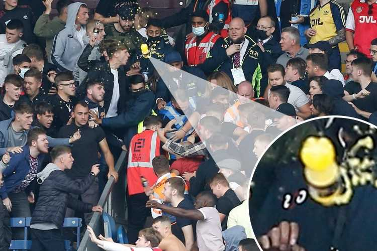 Burnley and Arsenal fans clash at Turf Moor as stewards forced to intervene and separate supporters