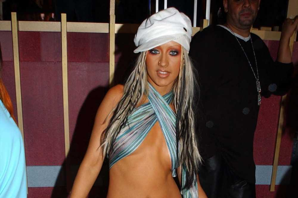 Christina Aguilera poses topless to recreate 'Stripped' album cover