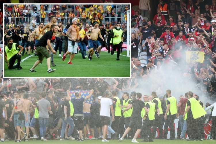 Lens vs Lille clash stopped as fans invade pitch and RIOT police are called in shameful French Ligue 1 scenes