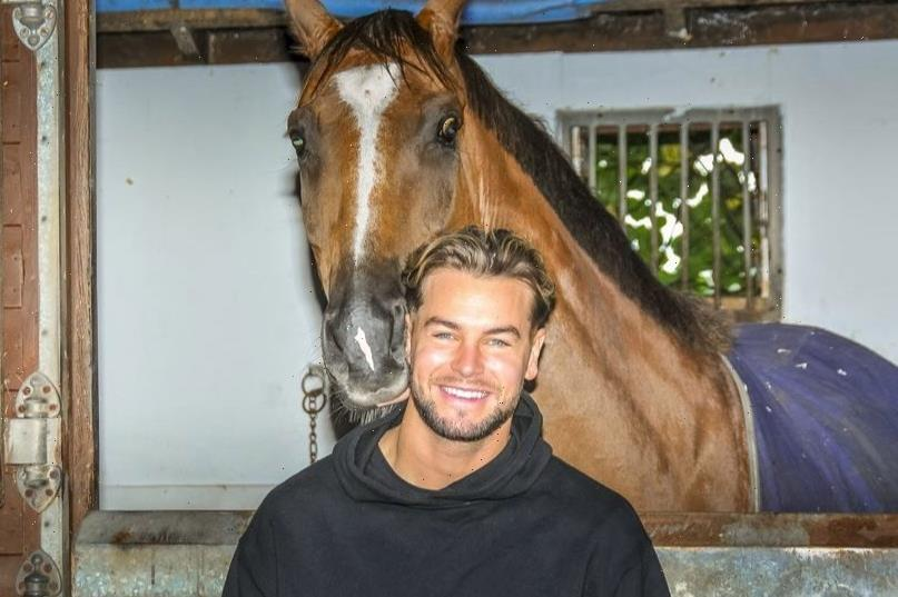 Love Island star Chris Hughes gets stuck in during National Racehorse Week