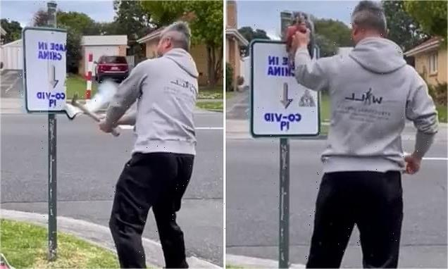 Man destroys 'racist' sign saying Covid is 'made in China