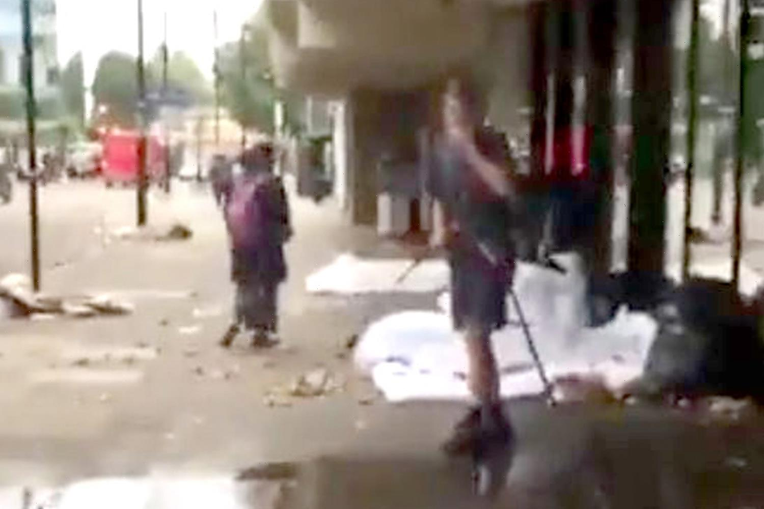 Street cleaner slammed for 'shooting' a homeless person with water from a jet washer while spraying the pavement