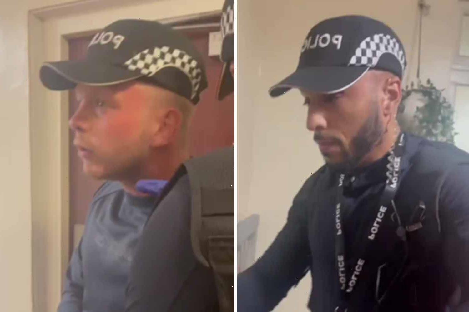 Chilling moment men dressed as fake cops with handcuffs & batons try to get into woman's home demanding to 'search it'